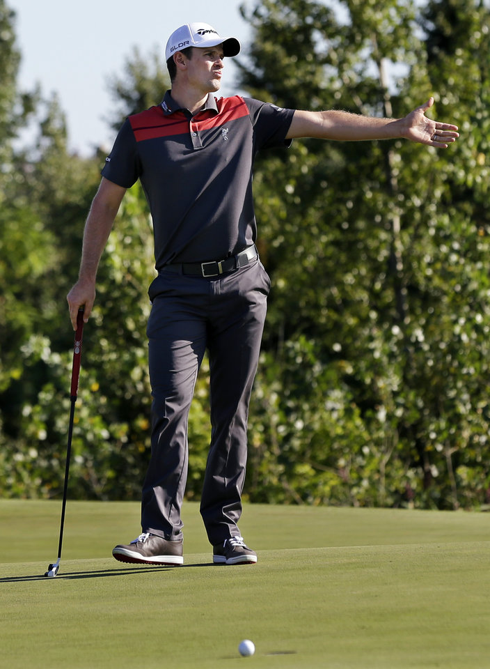 Photo - Justin Rose, of England, reacts to his missed putt on the 17th hole during the final round of The Barclays golf tournament on Sunday, Aug. 25, 2013, in Jersey City, N.J. Adam Scott won the tournament and Rose finished in a four-way tie for second. (AP Photo/Mel Evans)