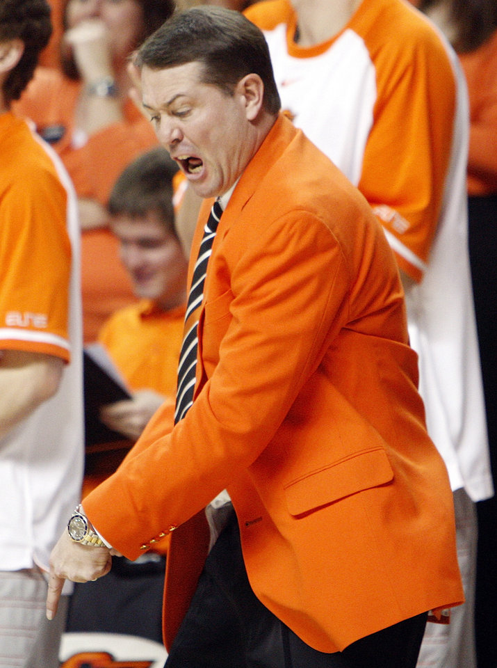 Photo - OSU head coach Travis Ford reacts in the second half during the Bedlam men's college basketball game between the Oklahoma State University Cowboys and the University of Oklahoma Sooners at Gallagher-Iba Arena in Stillwater, Okla., Monday, Jan. 9, 2012. OSU beat OU, 72-65. Photo by Nate Billings, The Oklahoman
