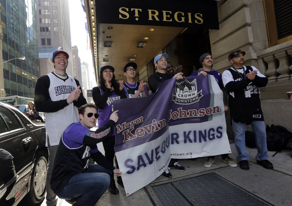 Photo - Sacramento Kings supporters gather outside the hotel where NBA owners are meetings regarding the possible relocation of the Sacramento Kings  team to Seattle, in New York,  Wednesday, April 3, 2013. Hedge fund manager Chris Hansen and Microsoft Chief Executive Steve Ballmer have agreed to buy a majority stake in the Kings from the Maloof family for $341 million, but the deal needs league approval. (AP Photo/Richard Drew)