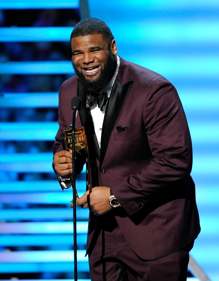 Photo - Sheldon Richardson of the New York Jets speaks after receiving the award for AP Defensive Rookie of the Year, at the third annual NFL Honors at Radio City Music Hall on Saturday, Feb. 1, 2014, in New York. (Photo by Evan Agostini/Invision for NFL/AP Images)