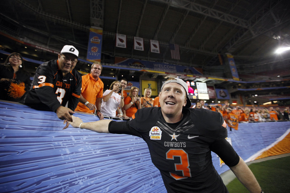 Oklahoma State's Brandon Weeden (3) celebrates with fans following the Fiesta Bowl between the Oklahoma State University Cowboys (OSU) and the Stanford Cardinal at the University of Phoenix Stadium in Glendale, Ariz., Tuesday, Jan. 3, 2012. Photo by Sarah Phipps, The Oklahoman