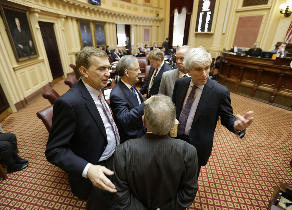 State Senators, Richard Saslaw, D-Fairfax, right, Charles Colgan, D-Prince William, back to camera, Emmett Hanger, R-Augusta, left, Thomas Norment, R-James City County, second from left, and John Watkins, R-Powhatan, second from right, discuss proceedings during a break in the Senate session at the Capitol in Richmond, Va., Friday, Feb. 22, 2013.  (AP Photo/Steve Helber)