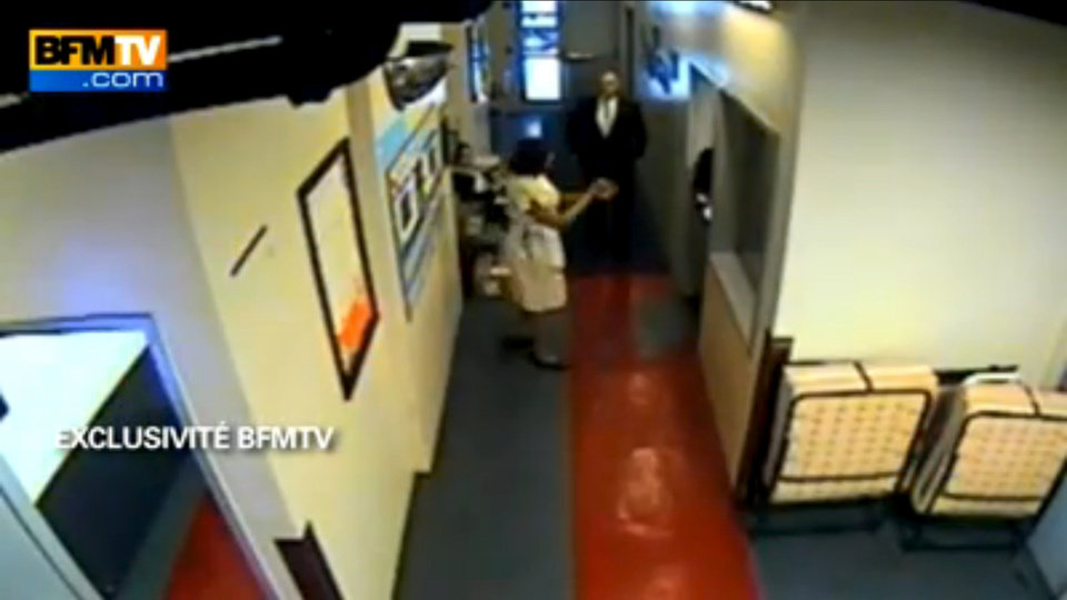 Photo -   In this image made from surveillance video obtained by France's BFM television and publicly aired for the first time Thursday, Dec. 8, 2011, hotel maid Nafissatou Diallo speaks to another hotel employee in a corridor reserved for Sofitel staff in New York on May 14, 2011. BFM said this was filmed about 40 minutes after an alleged attack on her by Dominique Strauss-Kahn. The video is the basis of recent news reports suggesting Strauss-Kahn might have been the target of a political plot. (AP Photo)