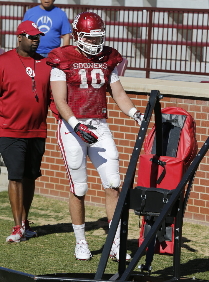 Photo - Blake Bell (10) gets personal attention during blocking drills as the University of Oklahoma Sooners (OU) begin spring practice on Owen Field at Gaylord Family-Oklahoma Memorial Stadium in Norman, Okla., on Tuesday, March 11, 2014. Photo by Steve Sisney, The Oklahoman