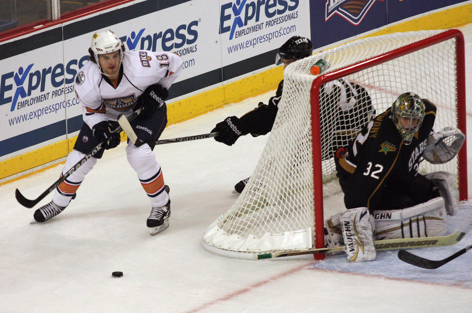 OKC's Ryan O'Marra (18) skates around the defending goal during a game between the Oklahoma City Barons and the Texas Stars at the Cox Convention Center in Oklahoma City, Saturday, Oct. 15, 2011.  Photo by Garett Fisbeck, The Oklahoman ORG XMIT: KOD