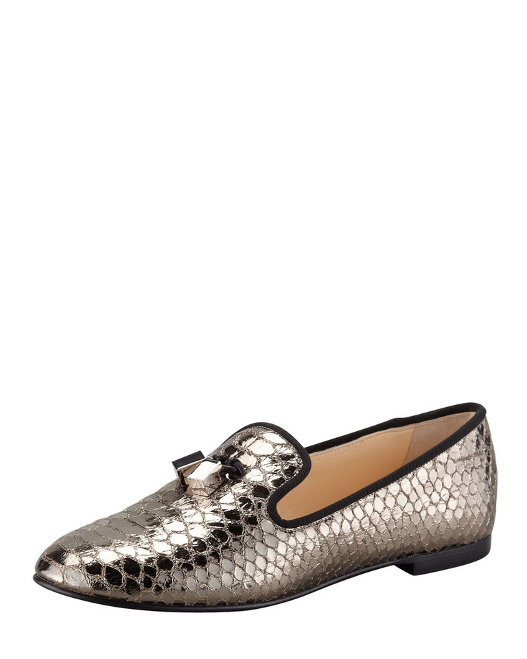 Photo - For those who follow the Chinese zodiac, the year of the snake begins Feb. 10. Some ways to incorporate the symbol of the year into your wardrobe, with no harm done to any living creature include this Giuseppe Zanotti snake-print smoking slipper, $625 from BergdorfGoodman.com. (BergdorfGoodman.com via Los Angeles Times/MCT)