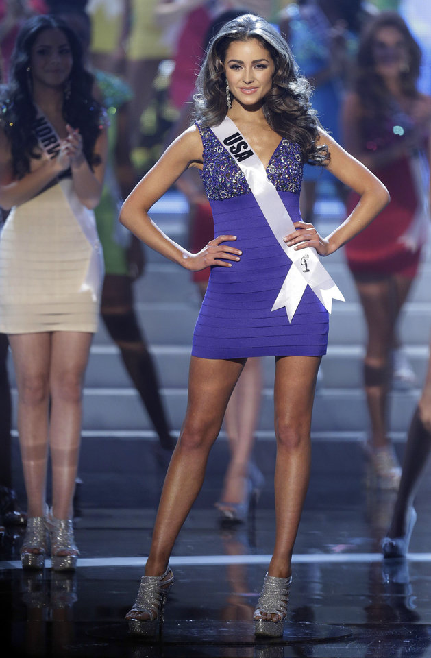Photo - Miss USA Olivia Culpo steps out as she is named one of the final 16 contestants during the Miss Universe pageant, Wednesday, Dec. 19, 2012, in Las Vegas. (AP Photo/Julie Jacobson)