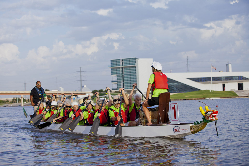 Photo -  Members of the Spanish Cove Golden Dragons practice rowing on the Oklahoma River. Photo provided by Debbie Miller.