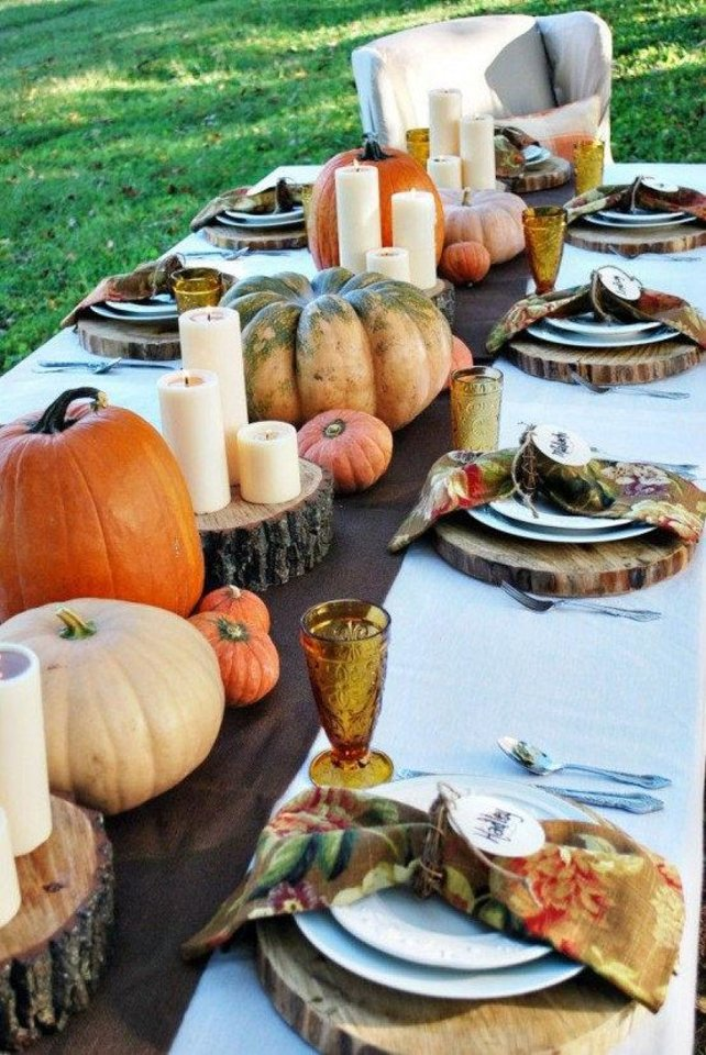 Photo - For an earthy, outdoors Thanksgiving meal, this idea from digsdigs.com uses natural elements to create a beautiful holiday table. Photo provided.