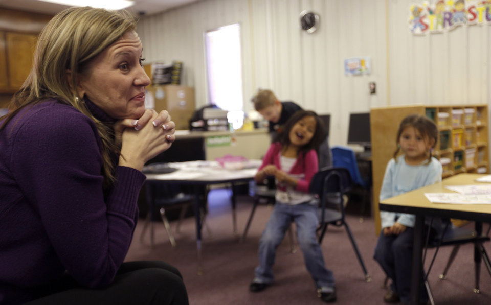 Kary Trent teaches pre-K at Ryal Public School, where educators work to help students overcome poverty�s effects.  Photo by Sarah Phipps, The Oklahoman