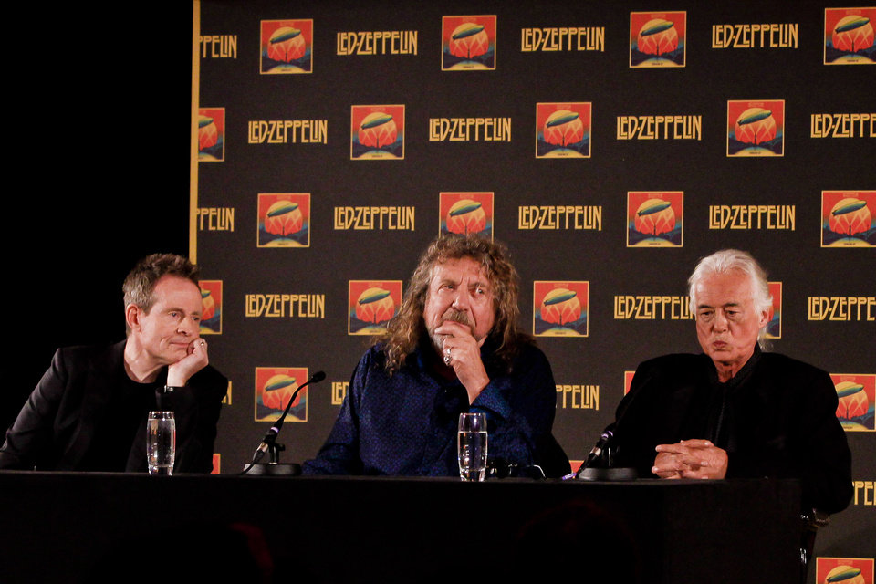 Photo -   Led Zeppelin bassist and keyboardist John Paul Jones, from let, frontman Robert Plant and guitarist Jimmy Page appear at a media screening ahead of the worldwide theatrical release of Led Zeppelin's 2007 Celebration Day concert at the O2, on Friday, Sept. 21, 2012, in London. (Photo by Miles Willis/Invision/AP)