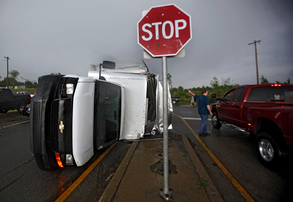 Photo - A truck lies on its side after a tornado damaged the area around I-40 and Choctaw Road on Monday, May 10, 2010, in Oklahoma City, Okla.  Photo by Chris Landsberger, The Oklahoman
