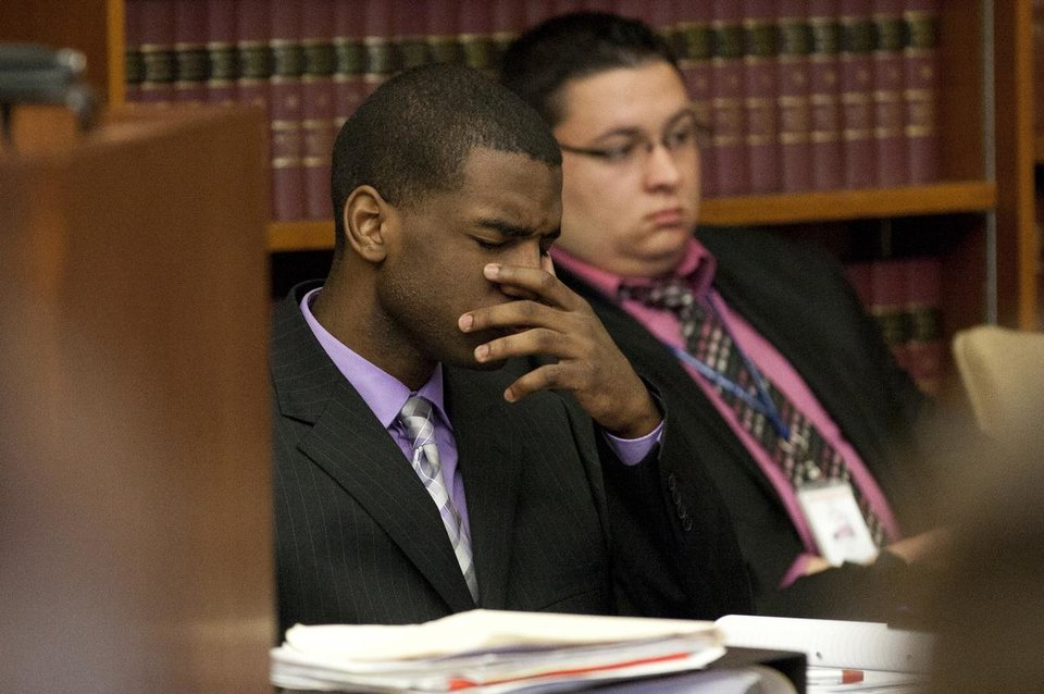 Photo - Ed Thomas reacts after listening to Kristopher Pratt testify during Thomas' trial at the Washtenaw County Trial Court in Ann Arbor, Mich., on Thursday, July 24, 2014. Thomas is on trial for the fatal shooting of Eastern Michigan University football player Demarius Reed.  (AP Photo/The Ann Arbor News, Patrick Record) LOCAL TELEVISION OUT; LOCAL INTERNET OUT