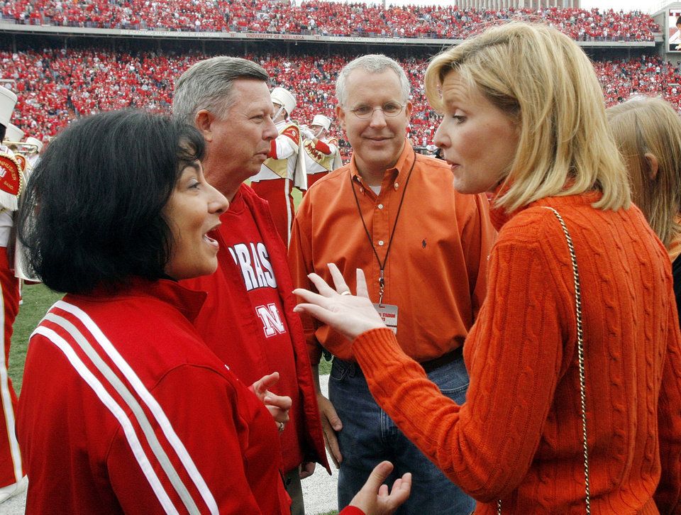 Photo - From left, Nebraska First Lady Sally Ganem and Nebraska Governor Dave Heineman talk with Oklahoma Governor Brad Henry and Oklahoma First Lady Kim Henry before the college football game between Oklahoma State University (OSU) and the University of Nebraska (NU) at Memorial Stadium in Lincoln, Neb., Saturday, October 13, 2007. By Nate Billings, The Oklahoman