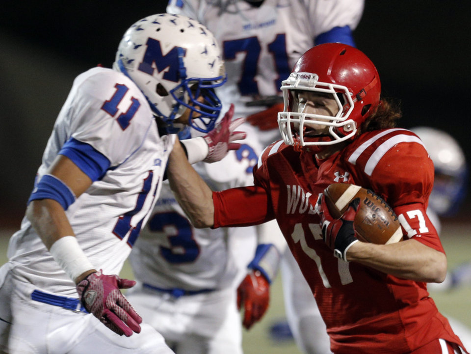 Photo - Davis' Blake Summers tries to get by Millwood's D'andre Mays during the Class 2A state football championship game between Davis and Millwood at Moore High School in Moore, Okla.,  Thursday, Dec. 19, 2013. Photo by Sarah Phipps, The Oklahoman