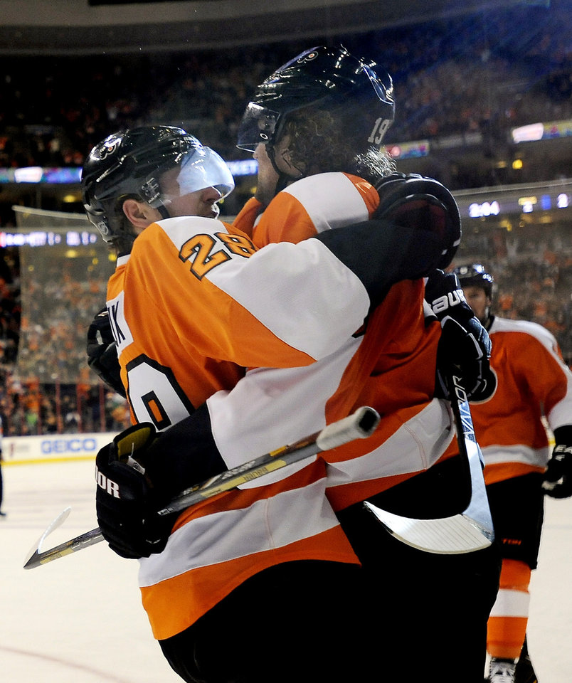 Philadelphia Flyers\' Claude Giroux, left, celebrates with Scott Hartnell after he scored a goal in the second period of an NHL hockey game against the Toronto Maple Leafs, Monday, Feb 25, 2013, in Philadelphia. (AP Photo/Michael Perez)