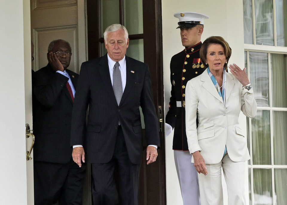 Photo - From left, Rep. James Clyburn, D-S.C., Rep. Steny Hoyer, D-Md., and House Minority Leader Nancy Pelosi of Calif., walk out of the West Wing of the White House to speak with reporters following their meeting with President Barack Obama and Vice President Joe Biden, Tuesday, Oct. 15, 2013, in Washington. The partial government shutdown is in its third week and less than two days before the Treasury Department says it will be unable to borrow and will rely on a cash cushion to pay the country's bills. (AP Photo/Pablo Martinez Monsivais)