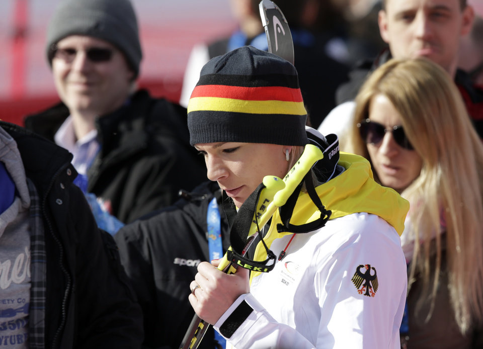 Photo - Germany's Maria Hoefl-Riesch leaves the finish area after competing in the downhill portion of the women's supercombined at the Sochi 2014 Winter Olympics, Monday, Feb. 10, 2014, in Krasnaya Polyana, Russia. (AP Photo/Gero Breloer)