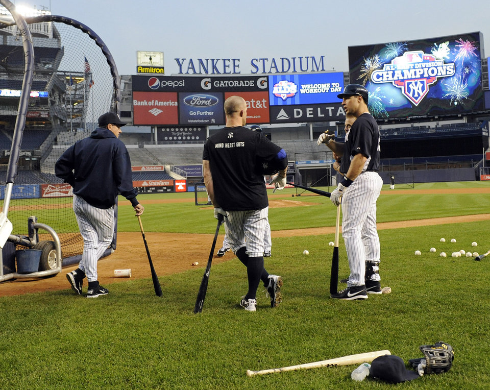 New York Yankees' Mark Teixeira, right, talks to teammates as they workout during baseball practice, Friday, Oct. 5, 2012, at Yankee Stadium in New York. They are preparing to play either the Baltimore Orioles or Texas Rangers in the American League division series. (AP Photo/Bill Kostroun)