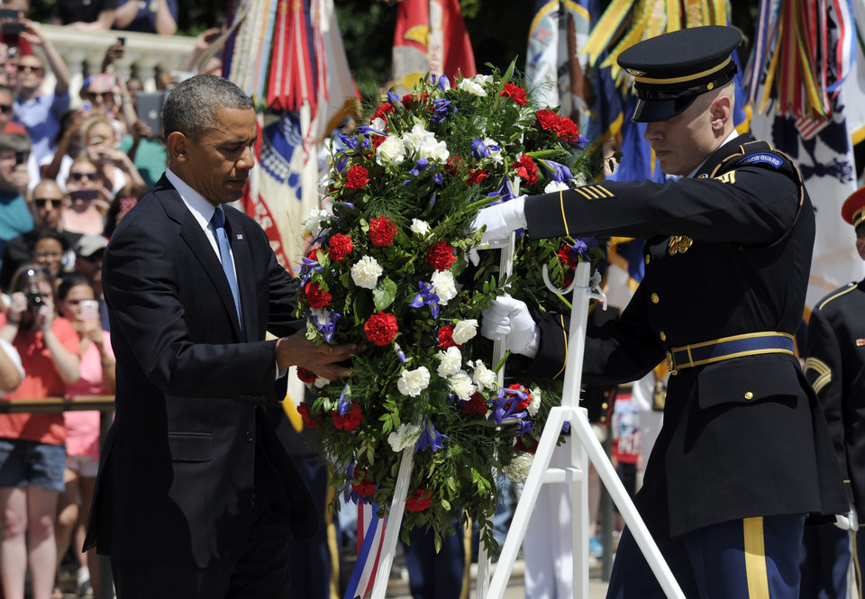 Photo - President Barack Obama lays a wreath at the Tomb of the Unknowns at Arlington National Cemetery in Arlington, Va., Monday, May 26, 2014.   President Obama is leading the nation in remembering its war heroes, the fallen and those still defending the flag, in a Memorial Day tribute.  (AP Photo/Susan Walsh)