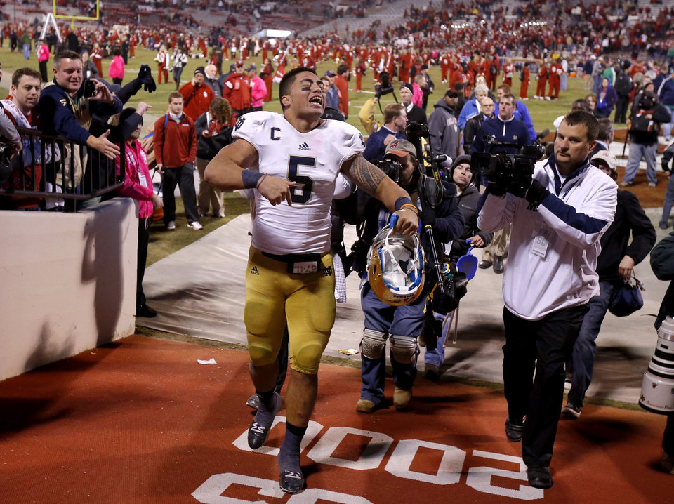 Photo - Notre Dame's Everett Golson (5) celebrates as he leaves the field after the college football game between the University of Oklahoma Sooners (OU) and the Notre Dame Fighting Irish at Gaylord Family-Oklahoma Memorial Stadium in Norman, Okla., Saturday, Oct. 27, 2012. Oklahoma lost 30-13. Photo by Bryan Terry, The Oklahoman