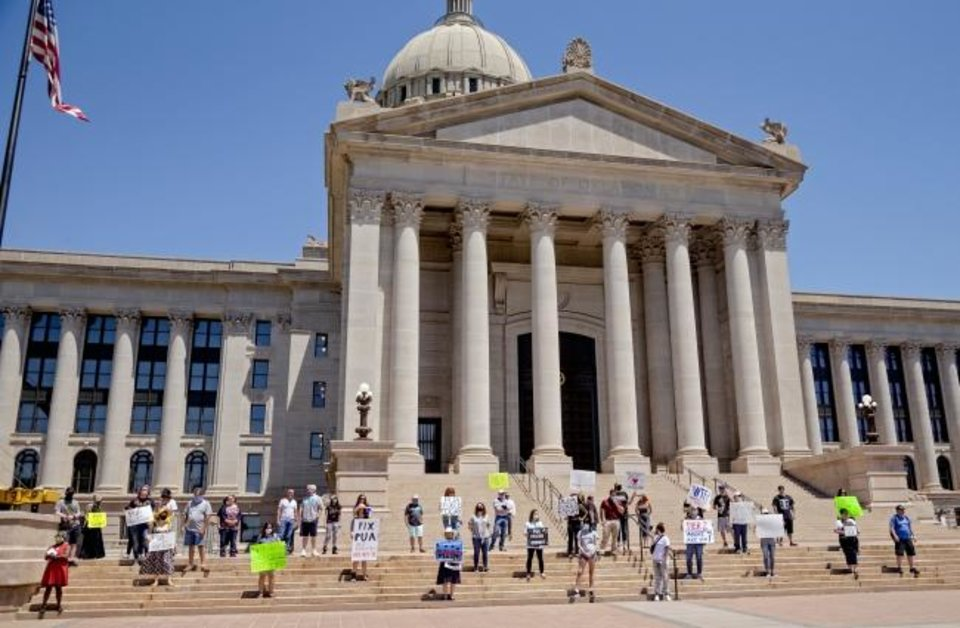 Photo -  Self-employed Oklahomans gathered at the Oklahoma state Capitol last week to protest the lack of unemployment payments.  [Chris Landsberger/The Oklahoman]
