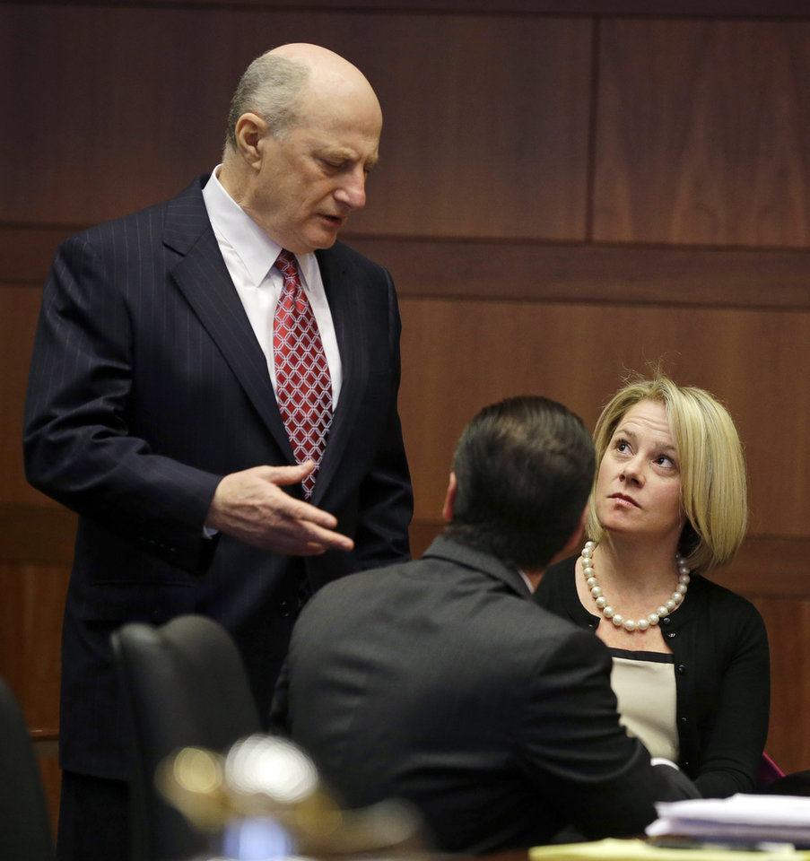 Photo - New Jersey Gov. Chris Christie's former Deputy Chief of Staff Bridget Anne Kelly, right, listens to her attorney Michael Critchley, left, as they wait in court for a hearing Tuesday, March 11, 2014, in Trenton, N.J. Attorneys for Kelly and two-time campaign manager Bill Stepien are in court to try to persuade a judge not to force them to turn over text messages and other private communications to New Jersey legislators investigating the political payback scandal ensnaring Christie's administration.  (AP Photo/Mel Evans, Pool)