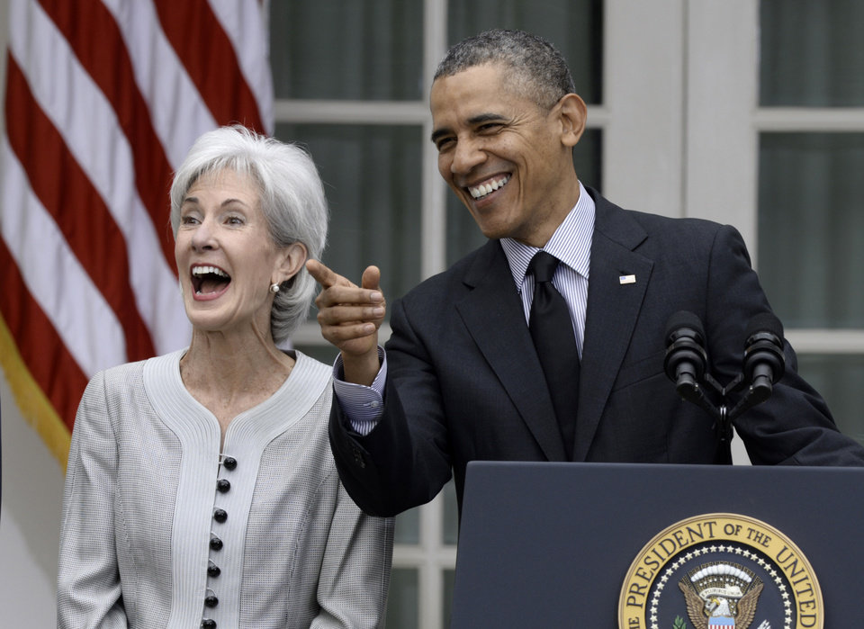 Photo - President Barack Obama shares a laugh with outgoing Health and Human Services Secretary Kathleen Sebelius, Friday, April 11, 2014, in the Rose Garden of the White House in Washington to announce he would nominate current Budget director Sylvia Mathews Burwell to replace Sebelius. (AP Photo/Susan Walsh)
