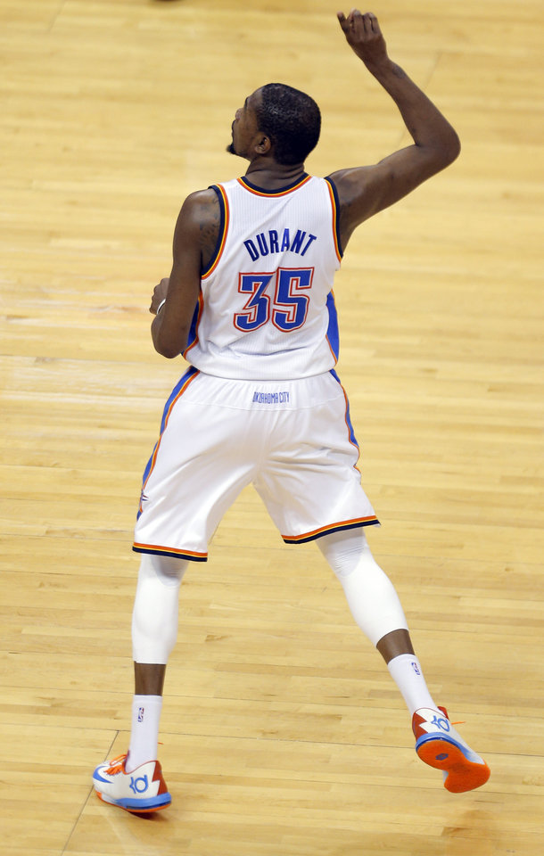 Photo - Oklahoma City's Kevin Durant (35) celebrates a 3-pointer in late in the third quarter during Game 2 in the first round of the NBA playoffs between the Oklahoma City Thunder and the Memphis Grizzlies at Chesapeake Energy Arena in Oklahoma City, Monday, April 21, 2014. Photo by Sarah Phipps, The Oklahoman