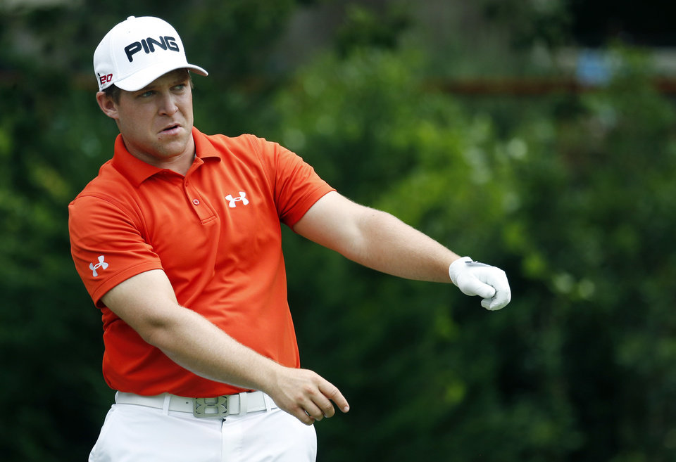 Photo - Daniel Summerhays loosens up prior to hitting off the eighth tee during the first round of the Sanderson Farms Championship golf tournament, Thursday, July 18, 2013, in Madison, Miss. (AP Photo/Rogelio V. Solis)