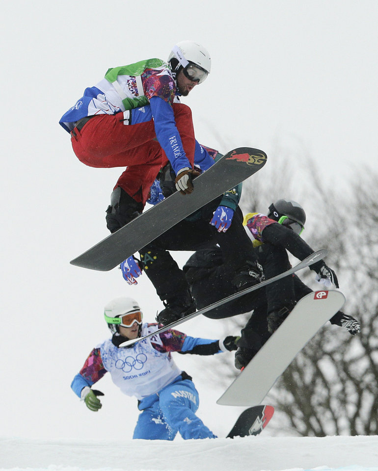 Photo - France's Pierre Vaultier, top, competes during the men's snowboard cross quarterfinal at the Rosa Khutor Extreme Park, at the 2014 Winter Olympics, Tuesday, Feb. 18, 2014, in Krasnaya Polyana, Russia. Vaultier won the gold medal. (AP Photo/Jae C. Hong)