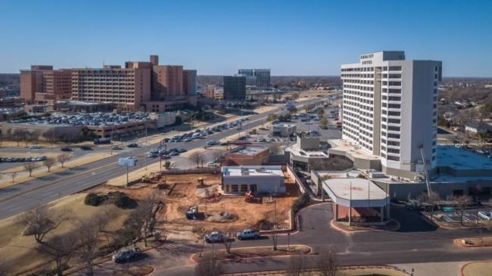 Photo -  A new McAlester's Deli can been to the right of the Embassy Suites, where Russell's nightclub once stood. The hotel, neglected for years, recently reopened after a $20 million renovation. Integris Baptist Medical Center is to the left. [DAVE MORRIS/THE OKLAHOMAN]