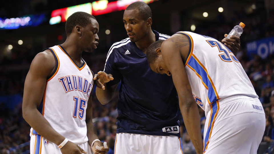 Thunder\'s Serge Ibaka, center, tells Reggie Jackson, left, to give the ball to Kevin Durant in the second half of an NBA basketball game where the Oklahoma City Thunder were defeated 95-93 by the Brooklyn Nets at the Chesapeake Energy Arena in Oklahoma City, on Thursday, Jan. 2, 2014. Photo by Steve Sisney, The Oklahoman