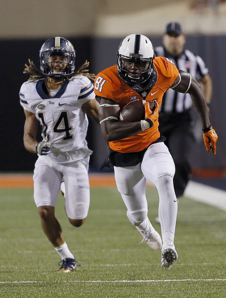 Photo - Oklahoma State's Jhajuan Seales (81) runs for a long reception as Pittsburgh's Avonte Maddox (14) chases him in the foruth quarter during a college football game between the Oklahoma State Cowboys (OSU) and the Pitt Panthers at Boone Pickens Stadium in Stillwater, Okla., Saturday, Sept. 17, 2016. Photo by Sarah Phipps, The Oklahoman