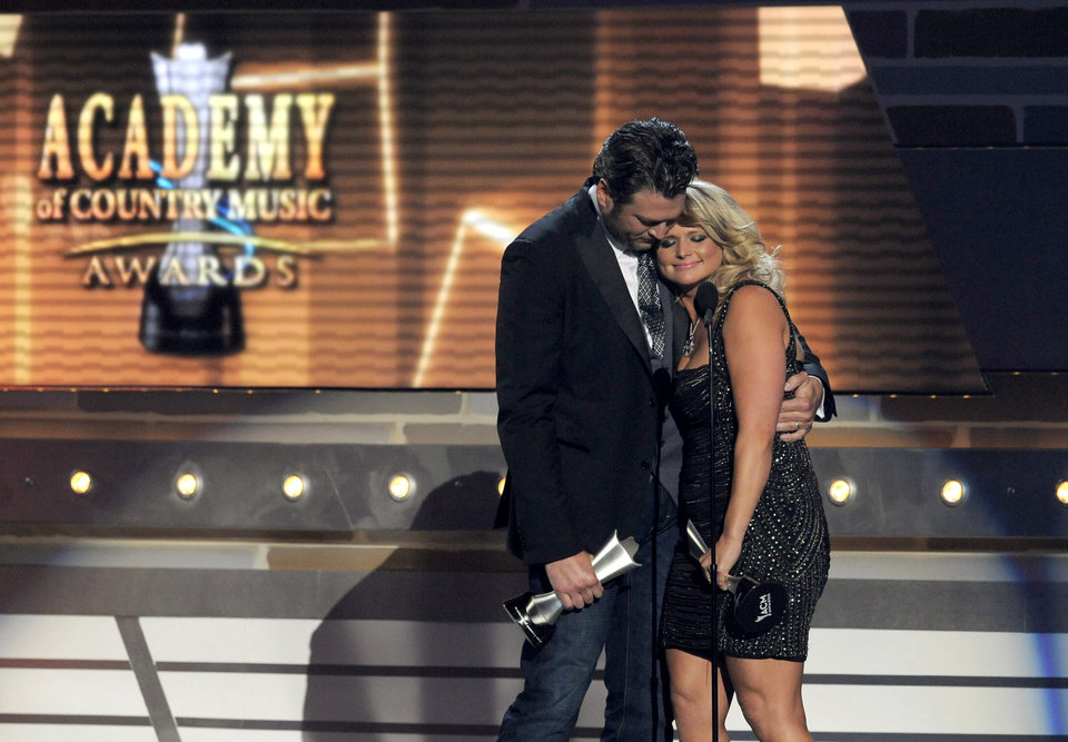 "Miranda Lambert, right, and Blake Shelton accept the award for song of the year for ""Over You"" at the 48th Annual Academy of Country Music Awards at the MGM Grand Garden Arena in Las Vegas on Sunday, April 7, 2013. (Photo by Chris Pizzello/Invision/AP) ORG XMIT: NVPM261"