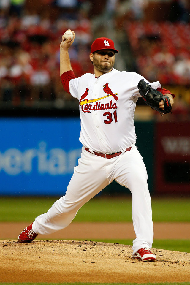 Photo - St. Louis Cardinals starting pitcher Lance Lynn throws during the first inning of a baseball game against the San Diego Padres Friday, Aug. 15, 2014, in St. Louis. (AP Photo/Scott Kane)