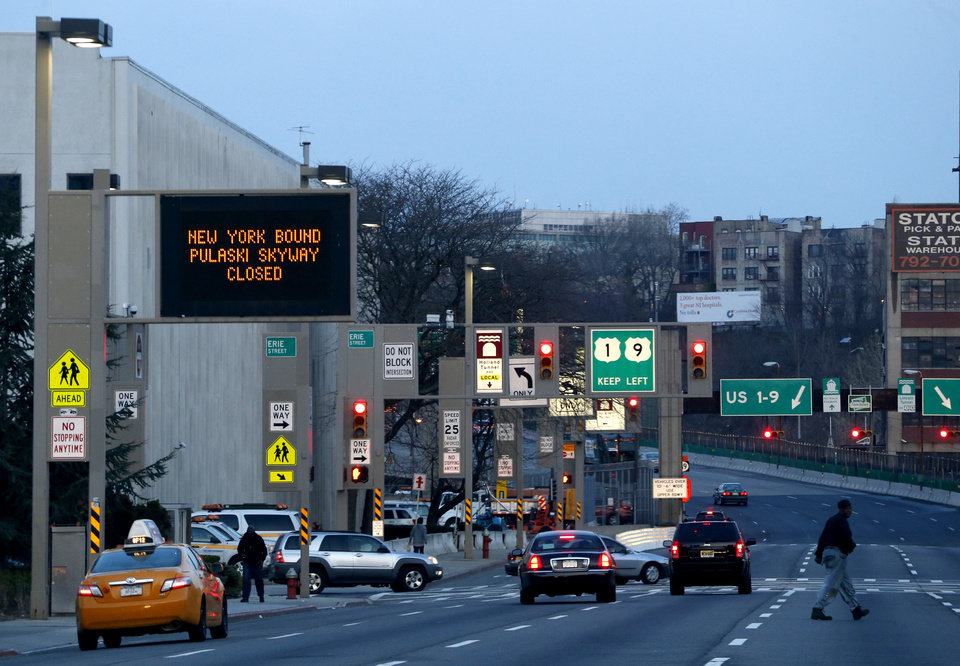 Photo - A sign alerts motorists of the Pulaski Skyway closure on the first week day of the two-year bridge closure, April 14, 2014, in Jersey City, N.J. The northbound side of the skyway was closed on Saturday, April 12, 2014, and will remain closed for two years while $1 billion in repairs are done to the aging bridge. An estimated 40,000 motorists who take the Skyway toward Jersey City and The Holland Tunnel every day are being urged to carpool, take the Turnpike extension or other alternate routes or use public transportation. (AP Photo/Julio Cortez)