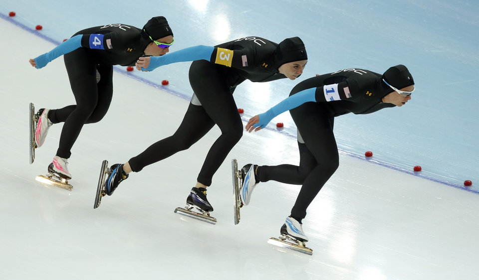 Photo - Speedskaters from the U.S. Jilleanne Rookard, Heather Richardson and Brittany Bowe, left to right, compete in the women's speedskating team pursuit quarterfinals at the Adler Arena Skating Center during the 2014 Winter Olympics in Sochi, Russia, Friday, Feb. 21, 2014. (AP Photo/Patrick Semansky)