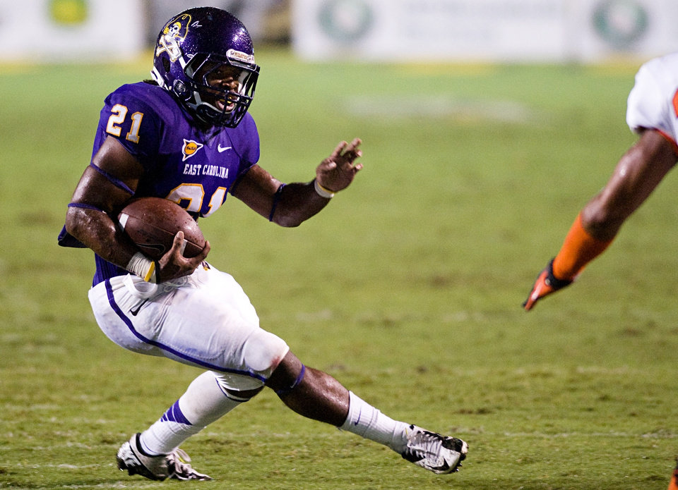 East Carolina\'s Vintavious Cooper (21) runs the ball against UTEP during an NCAA college football game Saturday, Sept. 29, 2012 at Dowdy-Ficklen Stadium in Greenville N.C. (AP PhotoThe Daily Reflector, Scott Davis)