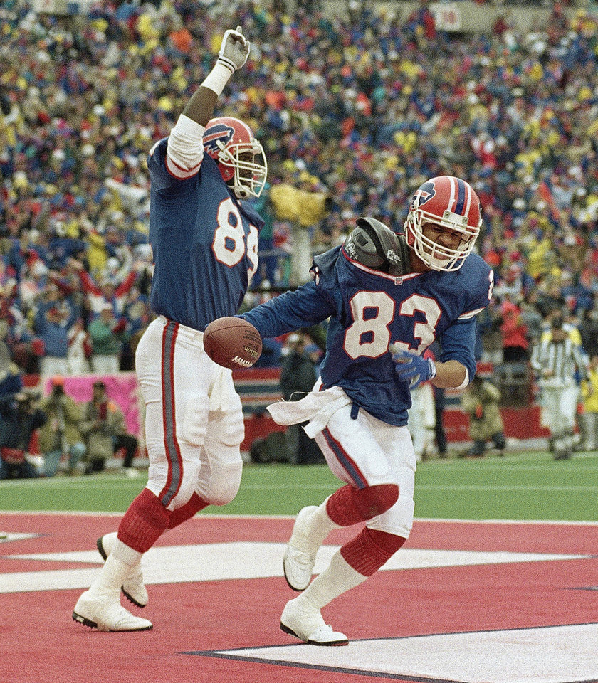 Photo - FILE - In this Jan. 4, 1993, file photo, Buffalo Bills wide receiver Andre Reed (83) and teammate Keith McKeller celebrate Reed's third touchdown,  during the fourth quarter  of an NFL game against the Houston Oilers at Rich Stadium in Orchard Park, N.Y. Reed awaits induction to the Pro Football Hall of Fame this weekend, and says the eight-year wait didn't feel that long.   (AP Photo/Bill Sikes, File)