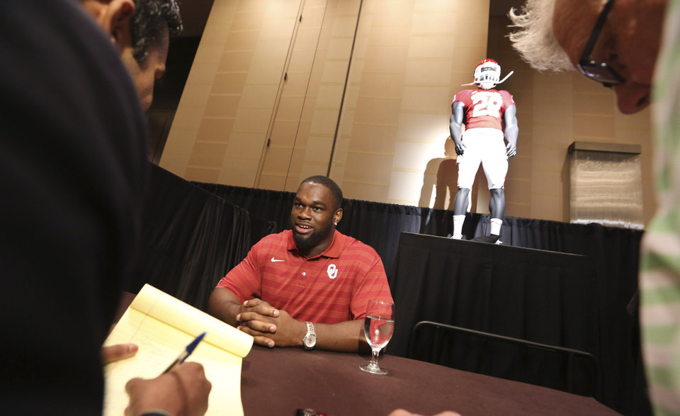 Photo - Oklahoma defensive tackle Chuka Ndulue answers a reporter's question at the Big 12 Conference NCAA college football media days in Dallas, Tuesday, July 22, 2014. (AP Photo)