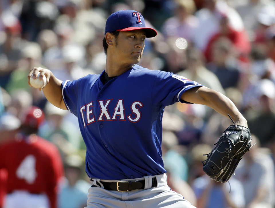 Photo - Texas Rangers' Yu Darvish throws before the second inning of an exhibition spring training baseball game against the Los Angeles Angels Tuesday, March 4, 2014, in Tempe, Ariz. (AP Photo/Morry Gash)