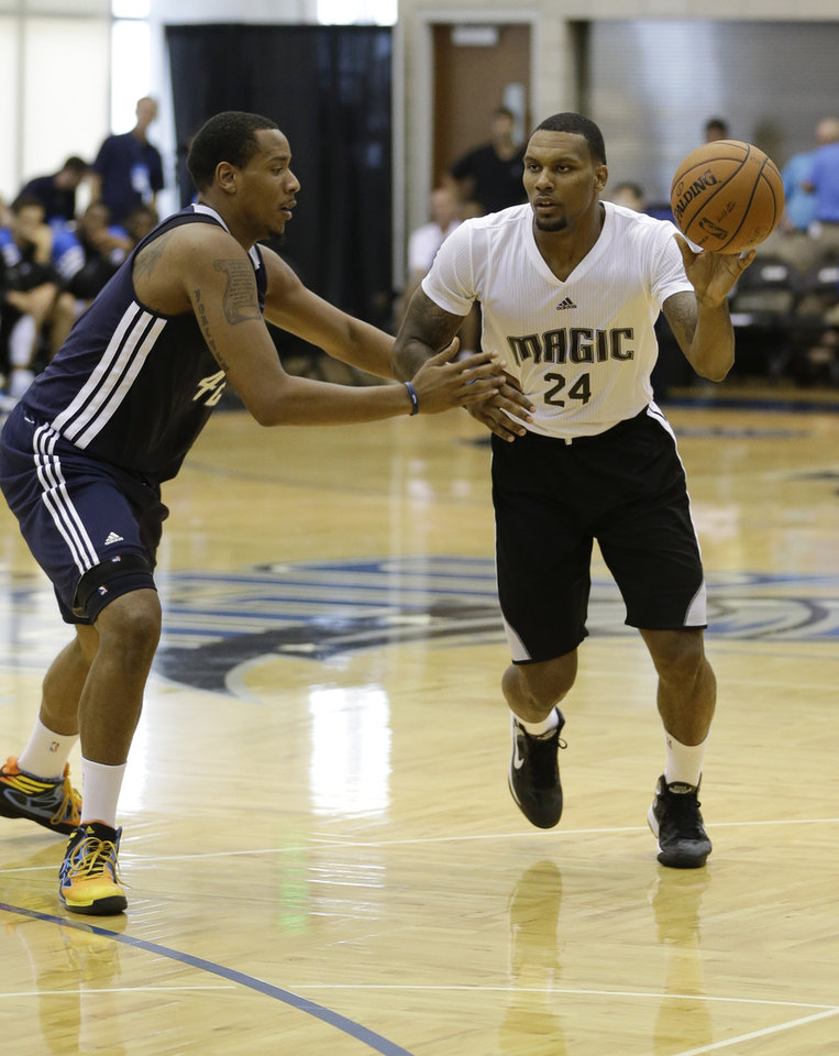 Orlando Magic's Romero Osby passes the ball around Oklahoma City Thunder's Ron Anderson during an NBA summer league basketball game, Monday, July 8, 2013, in Orlando, Fla. (AP Photo/John Raoux) ORG XMIT: DOA108