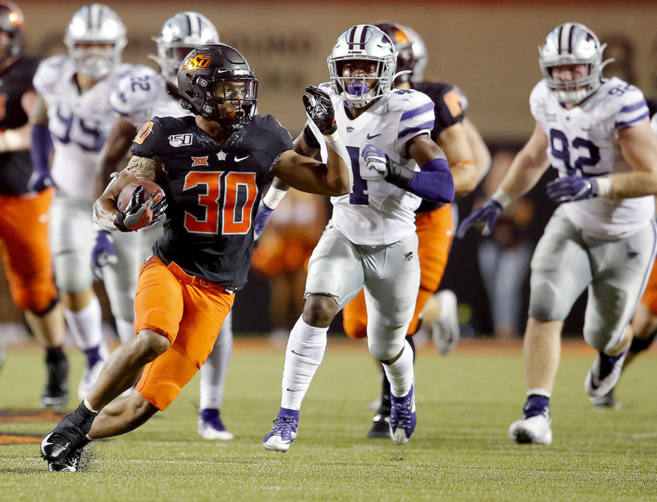 Photo - Oklahoma State's Chuba Hubbard (30) runs with the ball in the fourth quarter during the college football game between the Oklahoma State Cowboys and the Kansas State Wildcats at Boone Pickens Stadium in Stillwater, Okla., Saturday, Sept. 28, 2019.  OSU won 26-13. [Sarah Phipps/The Oklahoman]