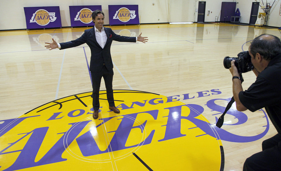 Newly acquired Los Angeles Lakers guard Steve Nash poses at center court for team photographer Andrew Bernstein after a news conference at the NBA basketball team\'s headquarters in El Segundo, Calif., Wednesday, July 11, 2012. The Lakers acquired two-time MVP Nash from the Phoenix Suns in exchange for first-round draft picks in 2013 and 2015 as well as second-round draft picks in 2013 and 2014, Lakers general manager Mitch Kupchak said. (AP Photo/Reed Saxon) ORG XMIT: CARS108