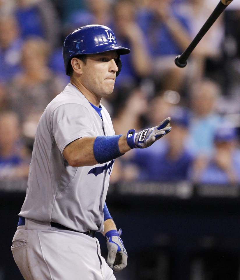 Photo - Los Angeles Dodgers' A.J. Ellis tosses his bat after getting hit by a pitch with bases loaded for the go ahead run in the eighth inning of a baseball game against the Kansas City Royals at Kauffman Stadium in Kansas City, Mo., Wednesday, June 25, 2014.   (AP Photo/Colin E. Braley)