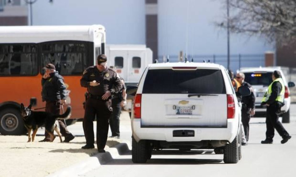 Oklahoma Highway Patrol bomb team and canines prepare to enter the Monroe Street parking garage after the garage was evacuated due to a bomb threat on the morning of Thursday, Feb. 13, 2014. Photo by KT King/The Oklahoman