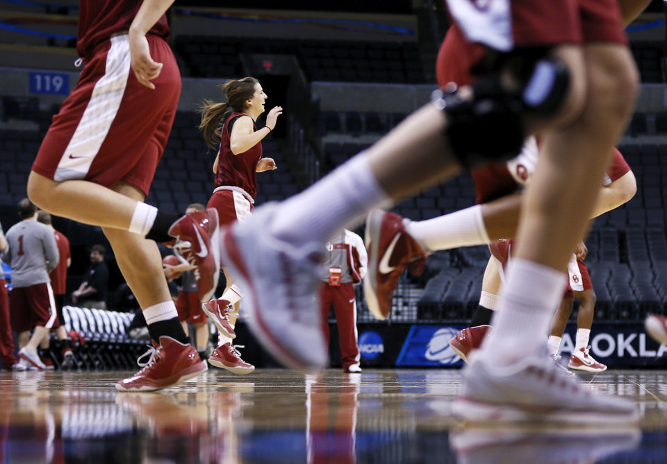 Morgan Hook (10) and the OU Sooners warm up during the press conference and practice day at the Oklahoma City Regional for the NCAA women\'s college basketball tournament at Chesapeake Energy Arena in Oklahoma City, Saturday, March 30, 2013. Photo by Nate Billings, The Oklahoman