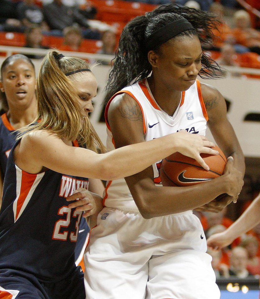 Photo - OSU's Toni Young (15) fights with Pepperdine's Katie Menton (23) for the ball during a first-round NIT women's college basketball game between Oklahoma State University (OSU) and Pepperdine at Gallagher-Iba Arena in Stillwater, Okla., Wednesday, March 16, 2011. Photo by Bryan Terry, The Oklahoman