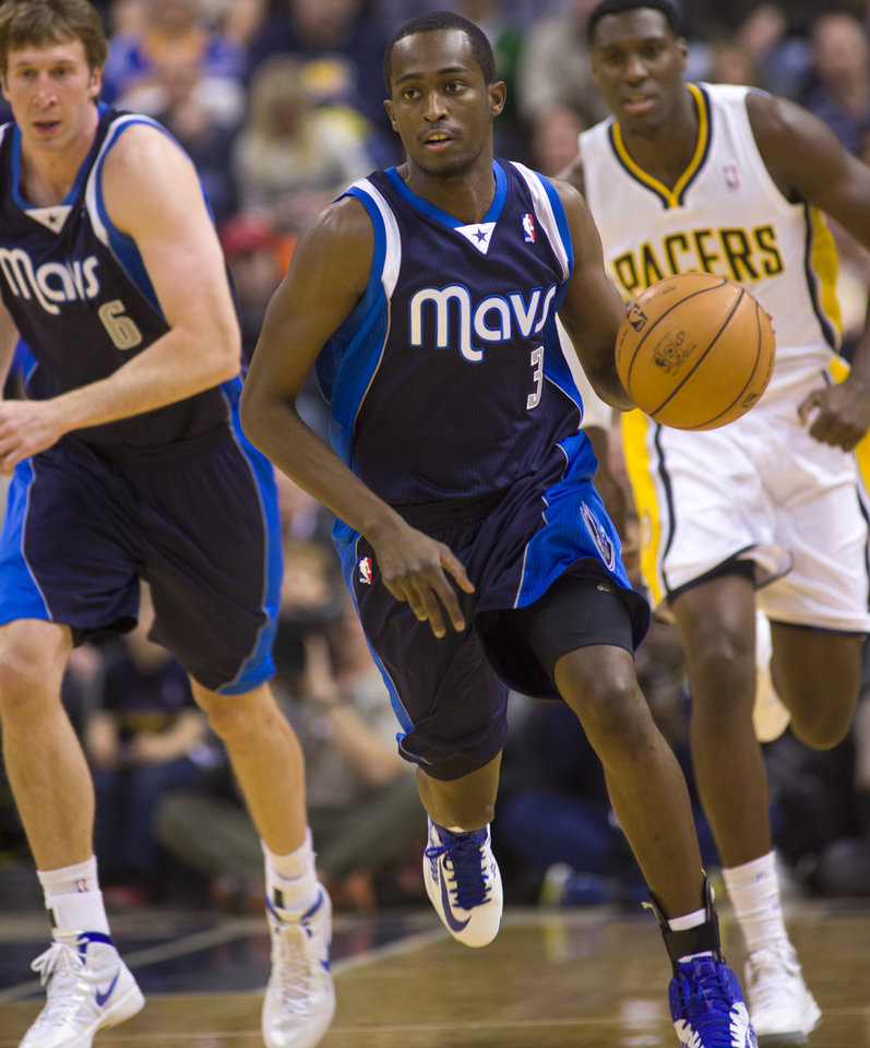 Photo -   Dallas Mavericks' Rodrigue Beaubois races the ball up court during the first half of an NBA basketball game against the Indiana Pacers in Indianapolis, Friday, Nov. 16, 2012. (AP Photo/Doug McSchooler)